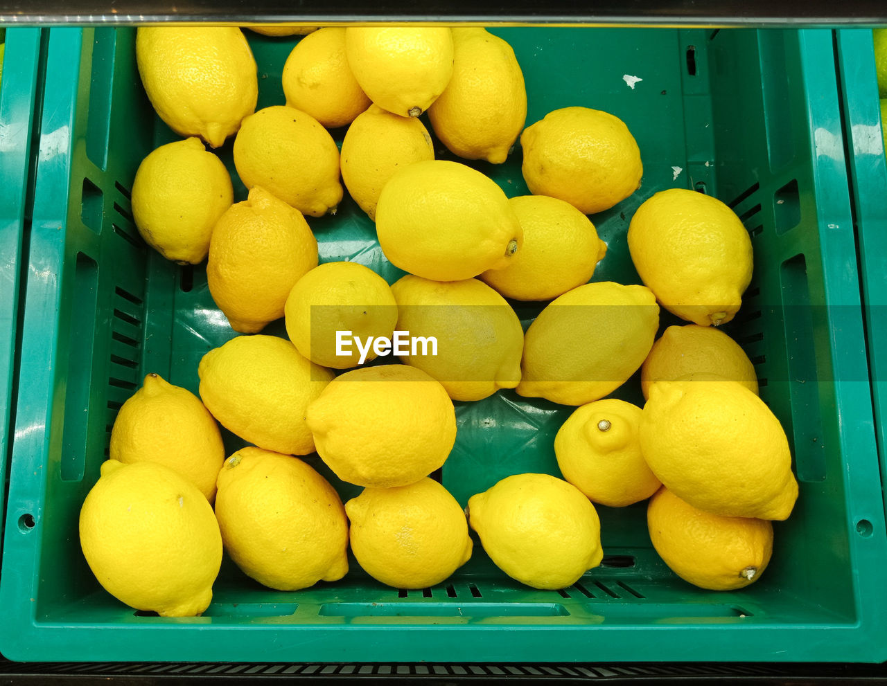 food and drink, healthy eating, food, yellow, wellbeing, container, fruit, box, large group of objects, freshness, citrus fruit, crate, still life, indoors, no people, close-up, abundance, retail, lemon, market, box - container, orange, ripe