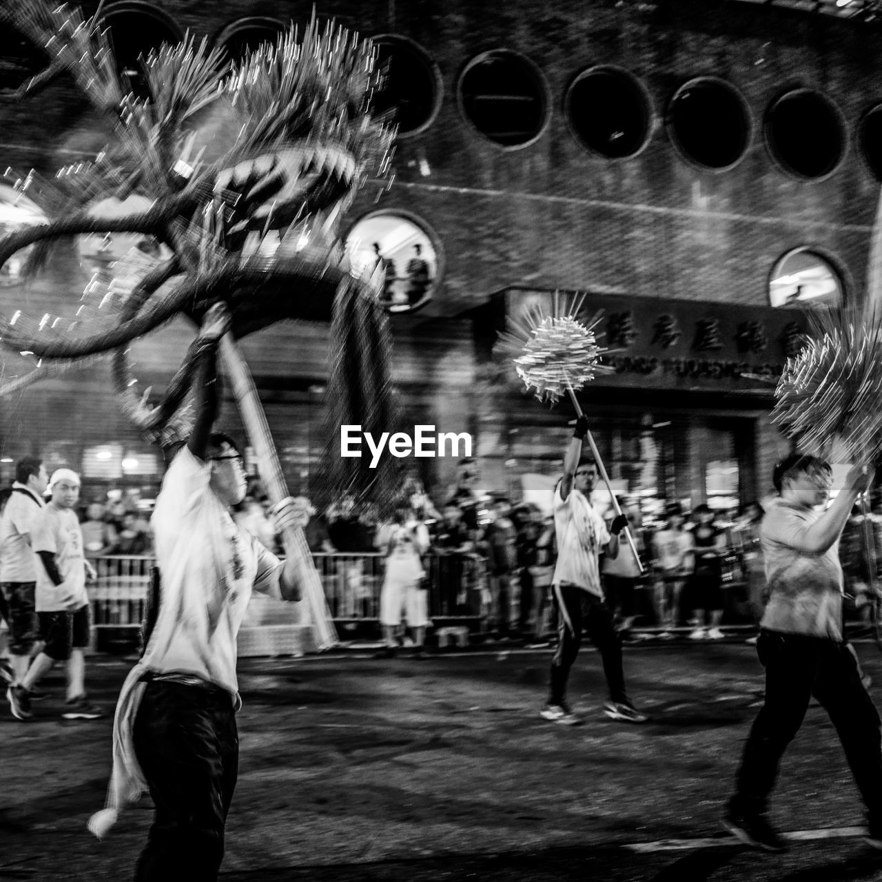 motion, group of people, blurred motion, real people, city, building exterior, architecture, built structure, men, street, leisure activity, women, lifestyles, people, medium group of people, group, adult, arts culture and entertainment, crowd, outdoors