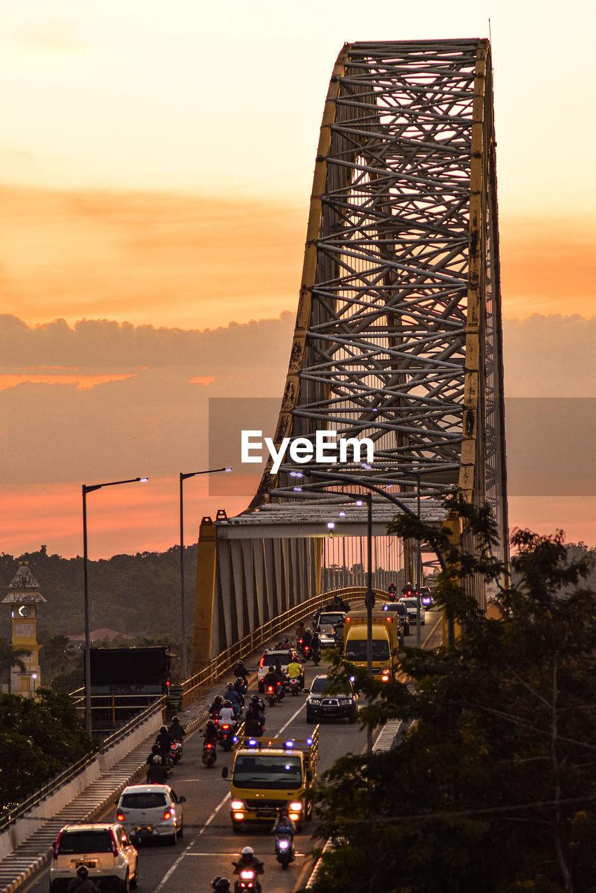 VIEW OF BRIDGE DURING SUNSET