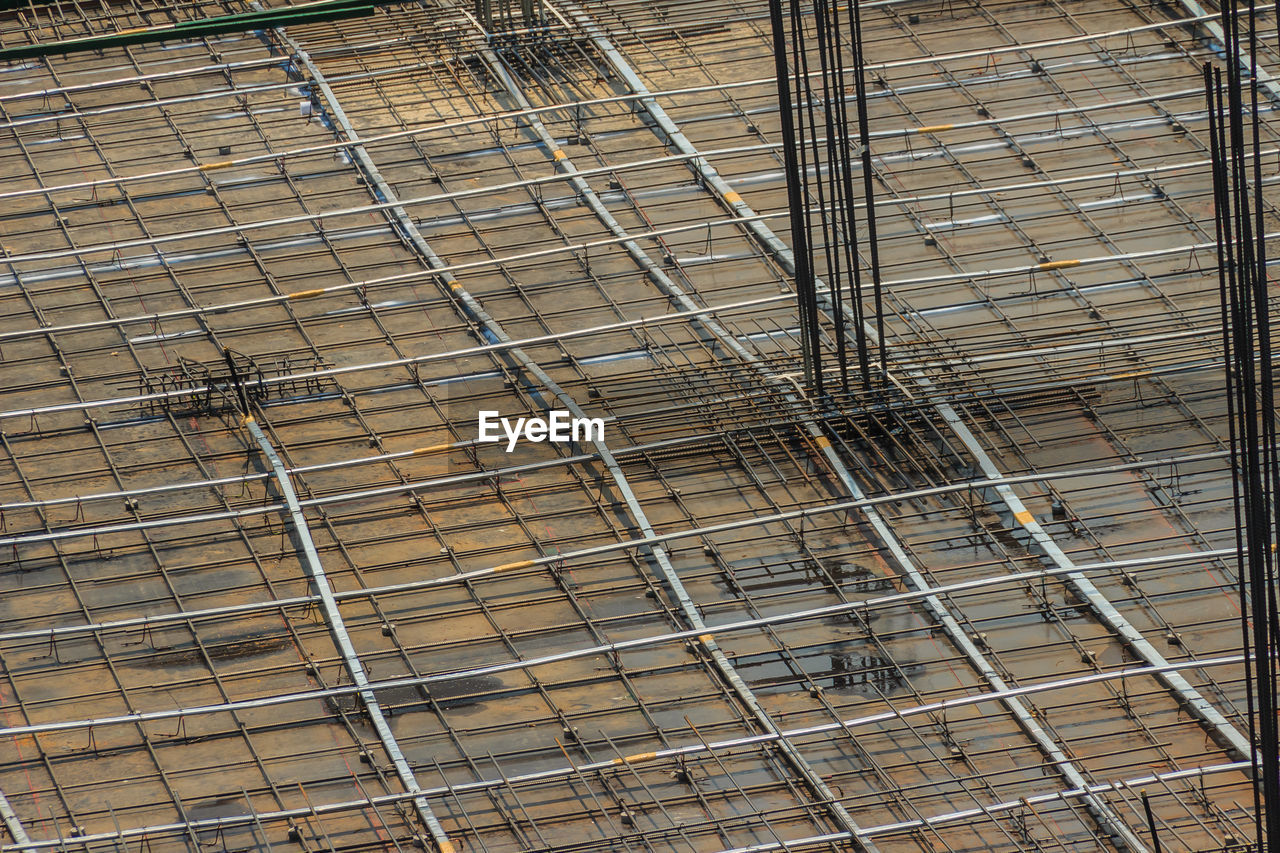 no people, metal, day, full frame, construction site, high angle view, protection, industry, outdoors, security, backgrounds, pattern, construction industry, fence, nature, safety, incomplete, grid, boundary, barrier