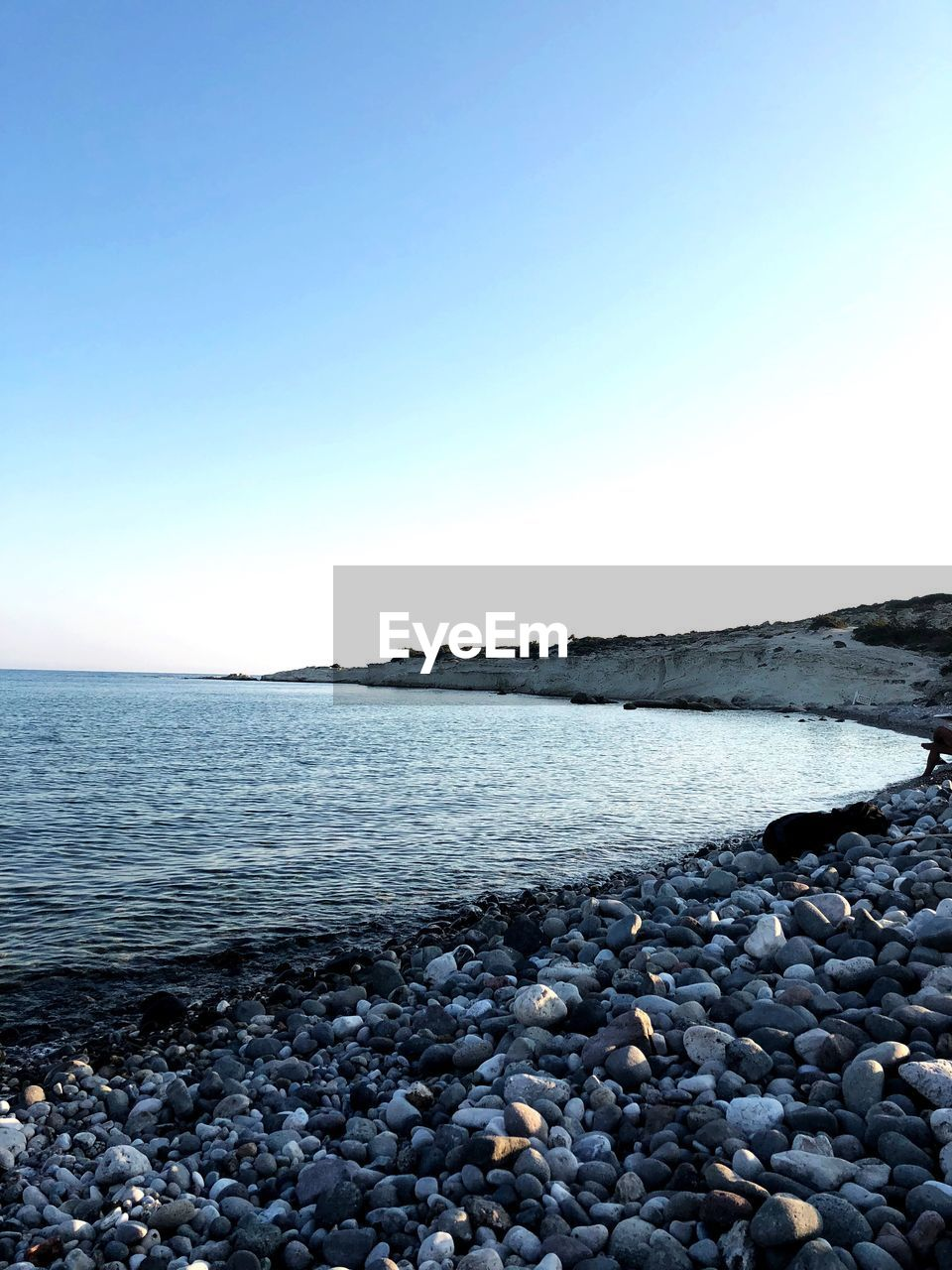 water, copy space, sky, pebble, clear sky, rock, sea, stone, solid, nature, beach, beauty in nature, land, stone - object, scenics - nature, tranquility, tranquil scene, no people, rock - object, horizon over water, outdoors