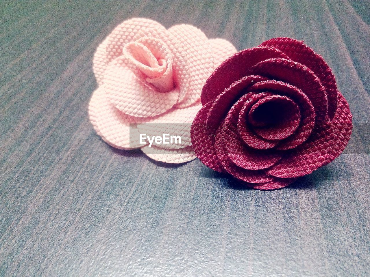 close-up, textile, no people, red, indoors, still life, high angle view, beauty in nature, table, pink color, pattern, flower, wool, rose, flowering plant, material, creativity, towel, nature, day, softness, warm clothing