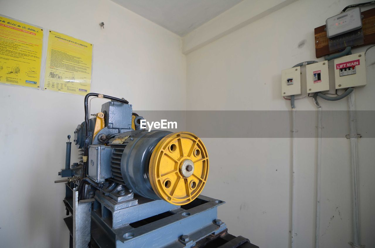 Machine against wall in room