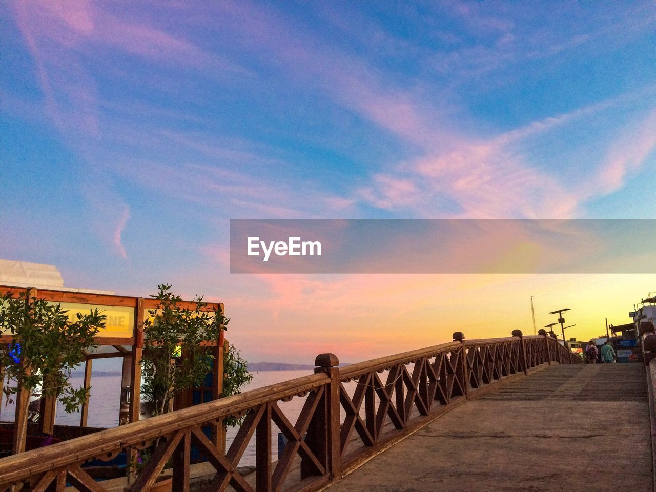 railing, sky, sunset, outdoors, built structure, architecture, nature, scenics, sea, beauty in nature, no people, day, tree