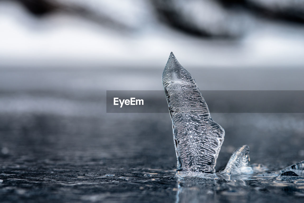 Close-Up Of Ice Floating In Water