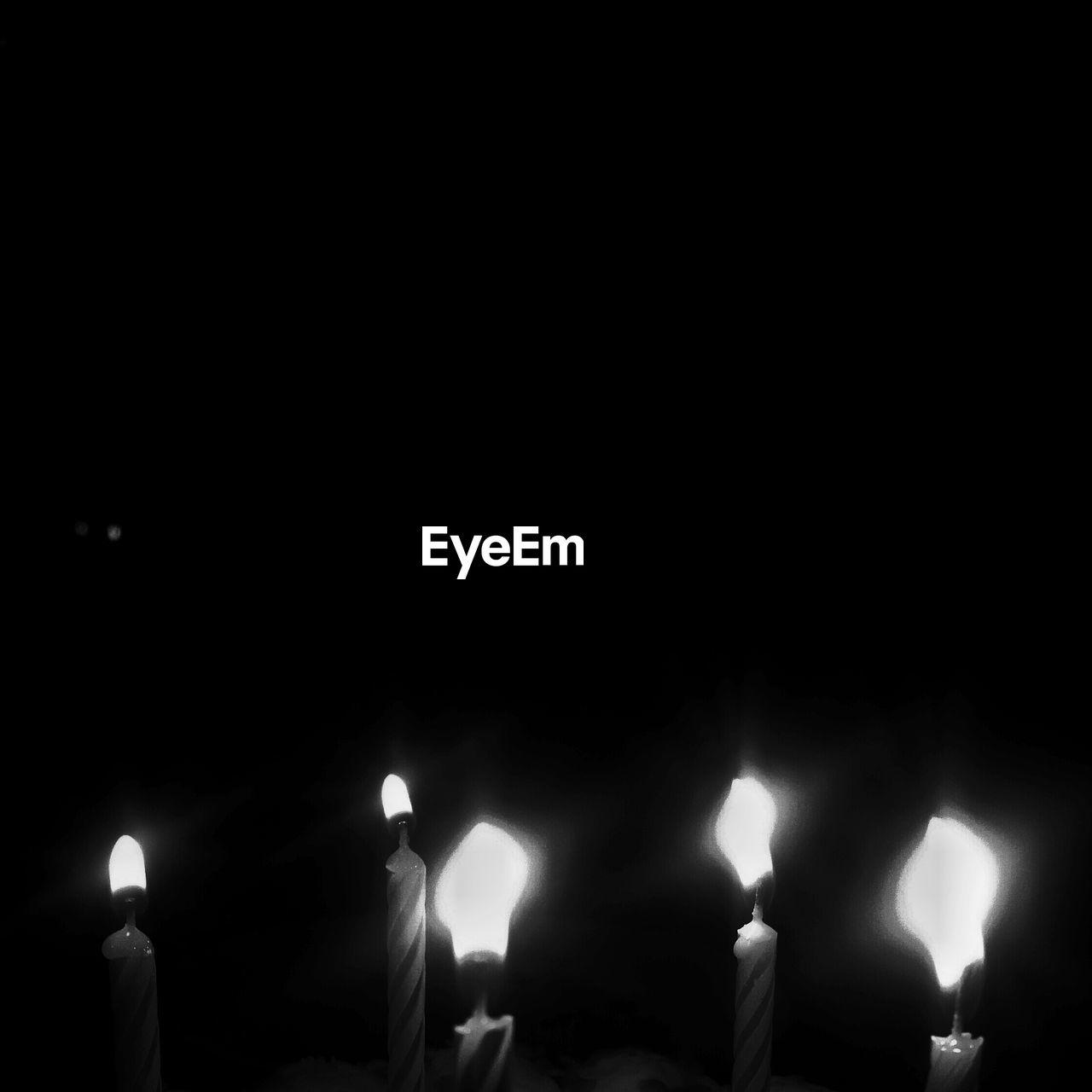flame, burning, candle, heat - temperature, glowing, illuminated, night, celebration, indoors, human body part, close-up, people