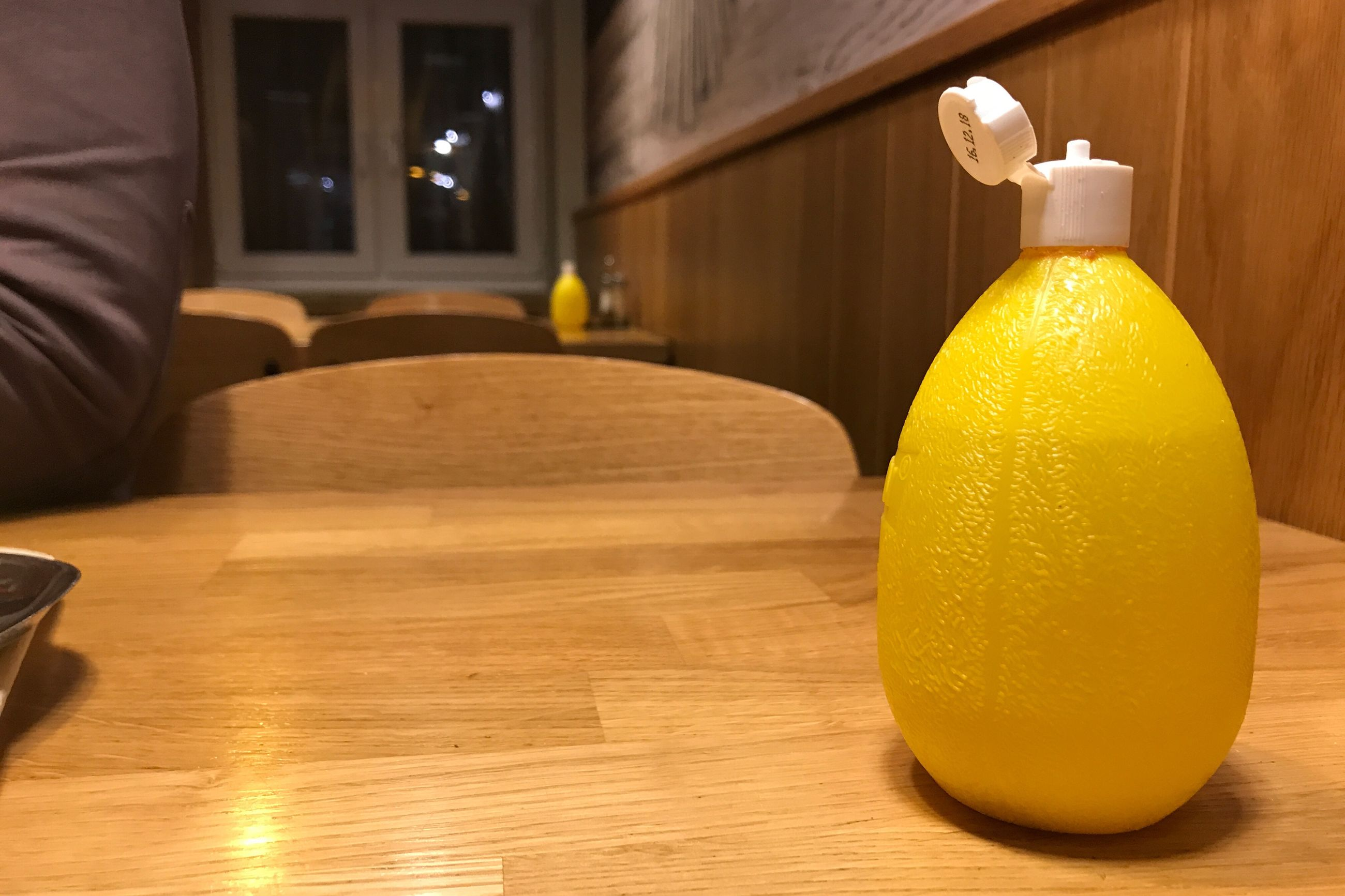 table, indoors, bottle, wood - material, yellow, drink, home interior, no people, freshness, close-up, day