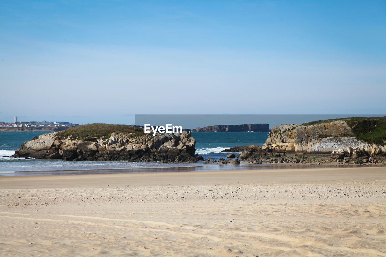 beach, sea, sand, nature, scenics, clear sky, outdoors, tranquility, rock - object, water, tranquil scene, no people, blue, beauty in nature, sky, day, horizon over water, blue sky