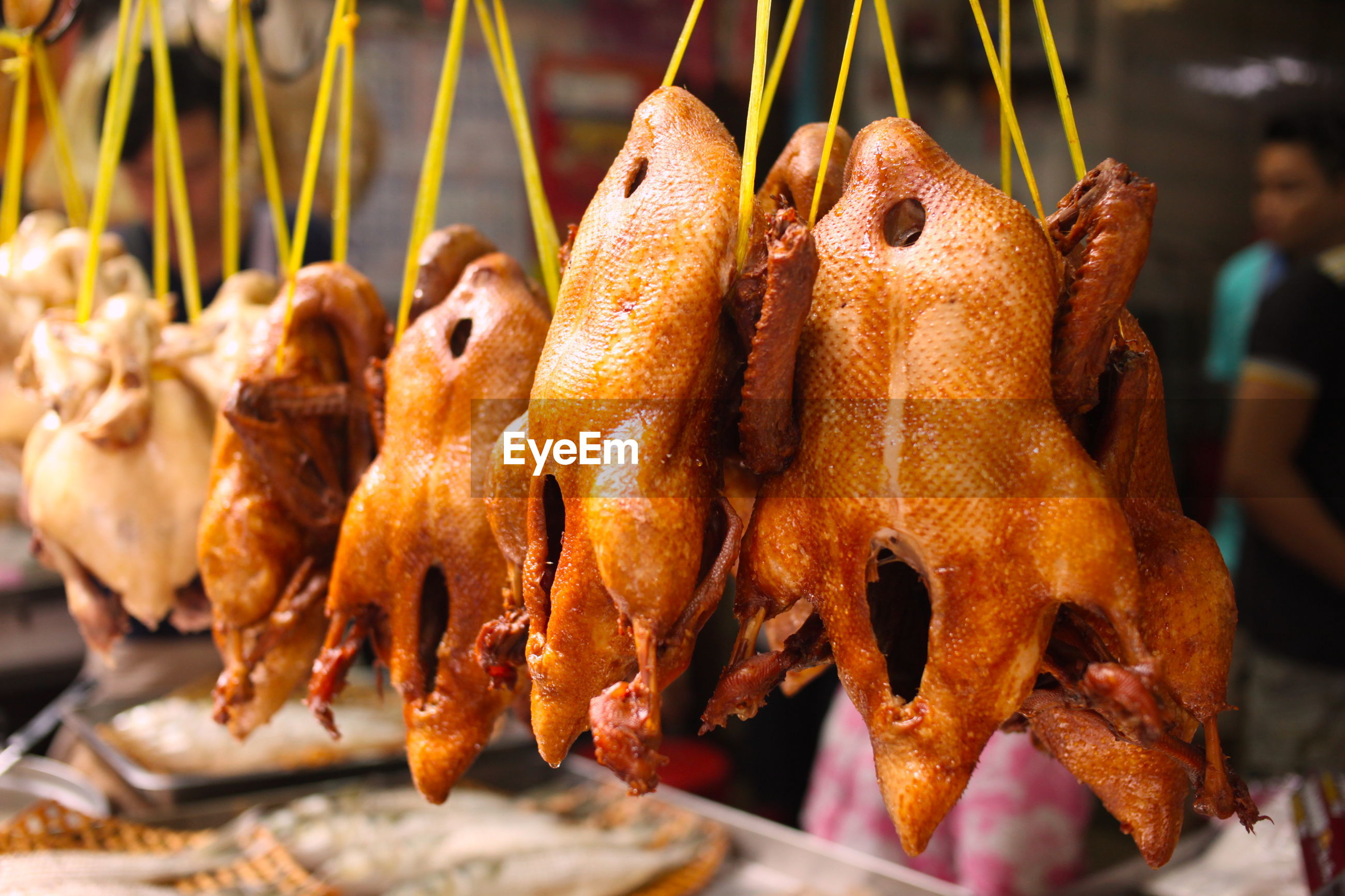 Close-up of roasted chicken for sale at market