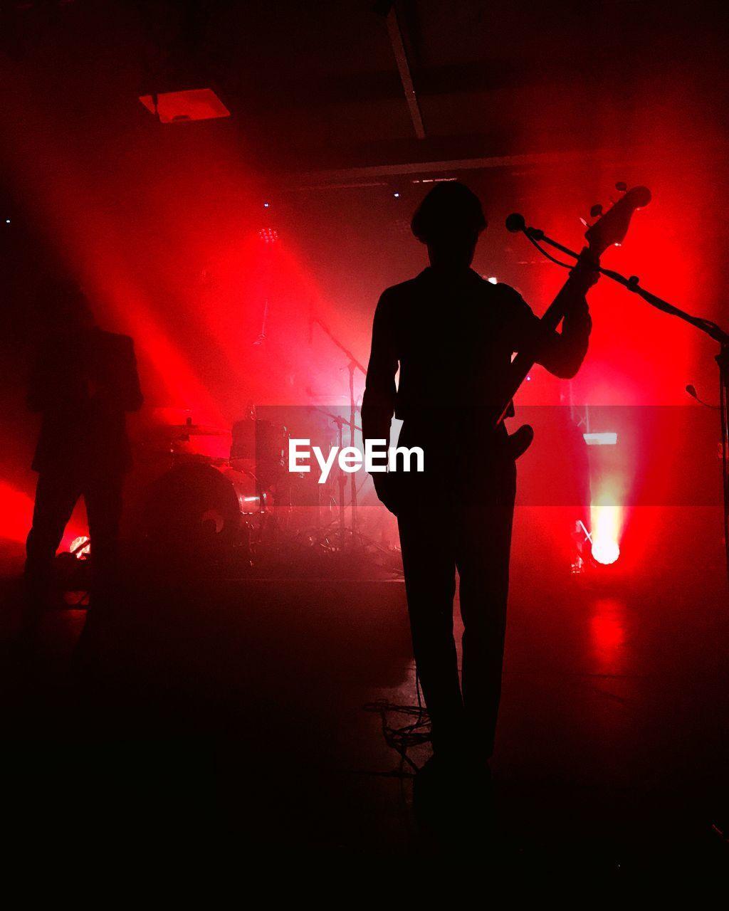 Silhouette Guitarist At Music Concert