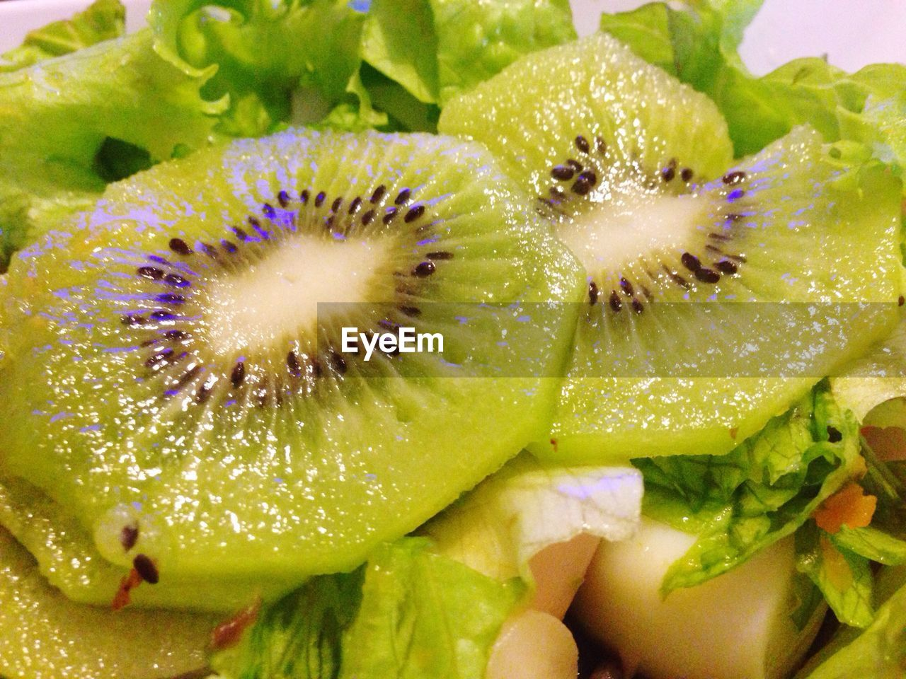 Close-up of kiwi on salad