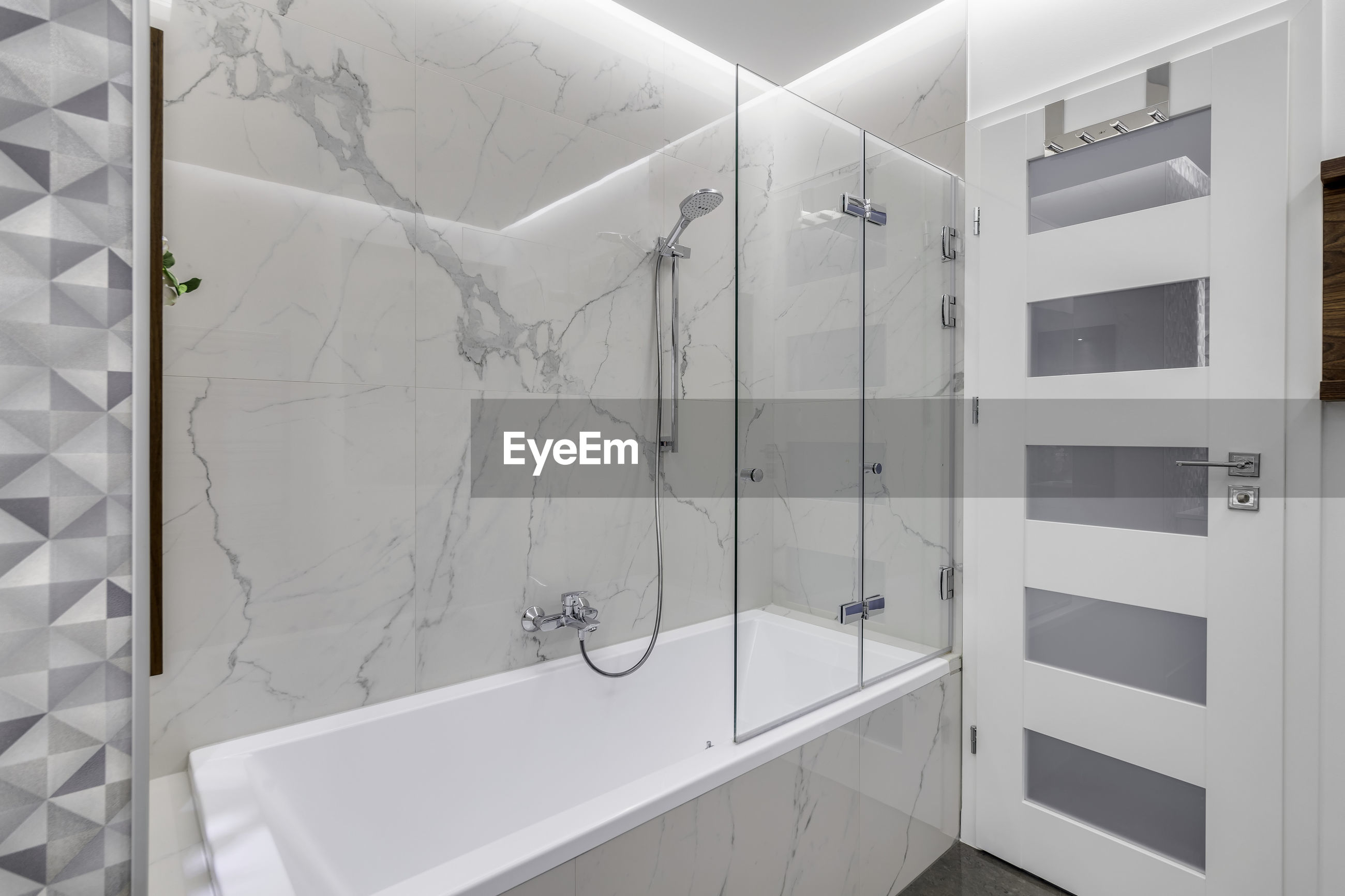 WHITE WALL OF BUILDING WITH BATHROOM