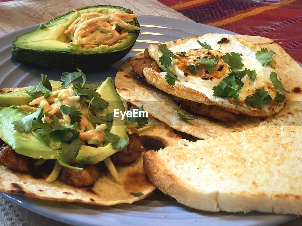 food and drink, food, freshness, plate, ready-to-eat, vegetable, healthy eating, no people, still life, fruit, mexican food, wellbeing, indoors, close-up, sandwich, avocado, tortilla chip, serving size, tortilla - flatbread, taco, meal, snack, vegetarian food, nacho chip, chopped