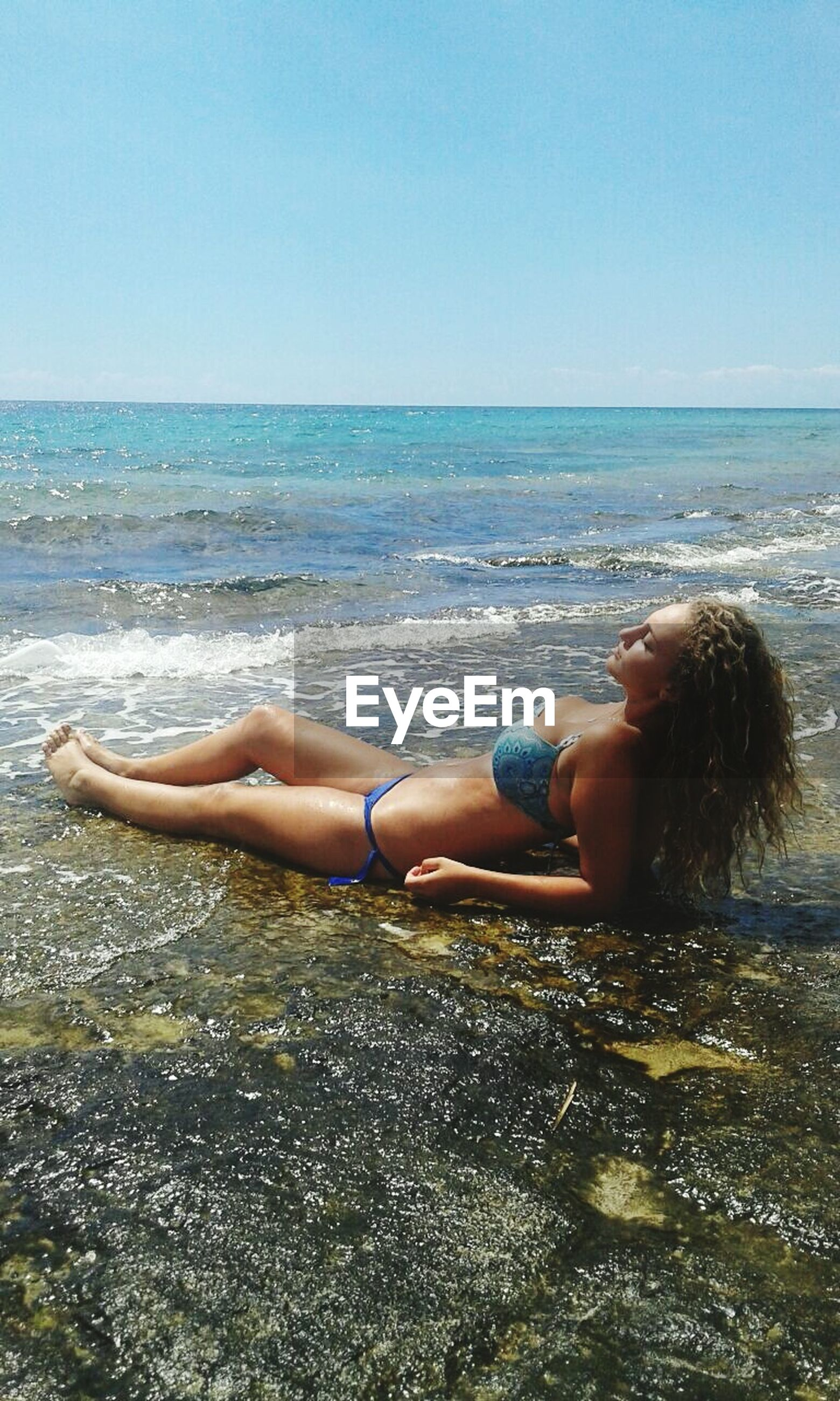 sea, horizon over water, beach, water, lifestyles, leisure activity, young adult, young women, shore, relaxation, clear sky, vacations, full length, person, sitting, bikini, sand