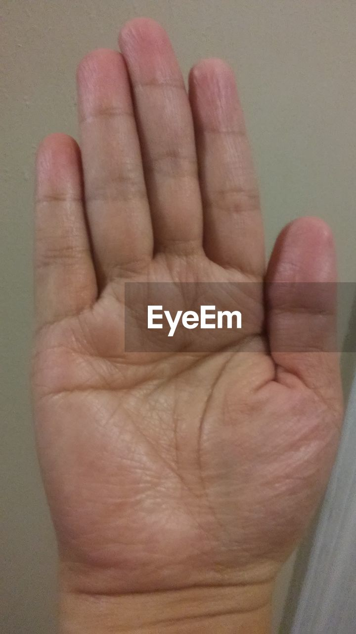 human body part, human hand, hand, body part, finger, human finger, real people, one person, close-up, unrecognizable person, indoors, personal perspective, gesturing, palm, men, hand sign, showing, human foot, emotion, human limb