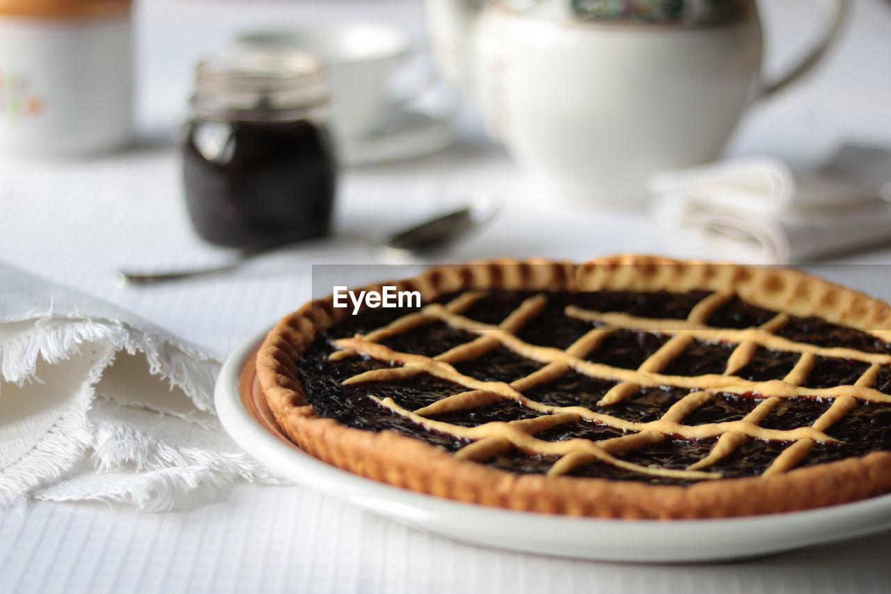 food and drink, food, sweet food, dessert, sweet, indulgence, freshness, ready-to-eat, baked, temptation, indoors, unhealthy eating, table, selective focus, still life, plate, pie, serving size, cake, sweet pie, no people, tart - dessert, snack, baked pastry item, breakfast