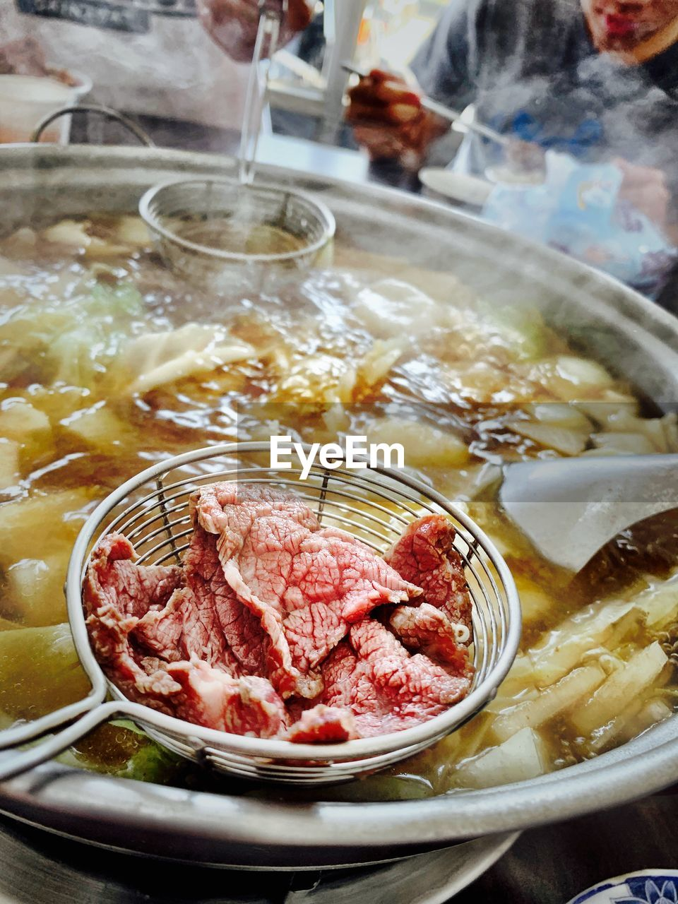 food and drink, food, freshness, meat, indoors, preparation, bowl, close-up, table, red meat, ready-to-eat, beef, healthy eating, wellbeing, incidental people, kitchen utensil, household equipment, high angle view, business, preparing food, temptation