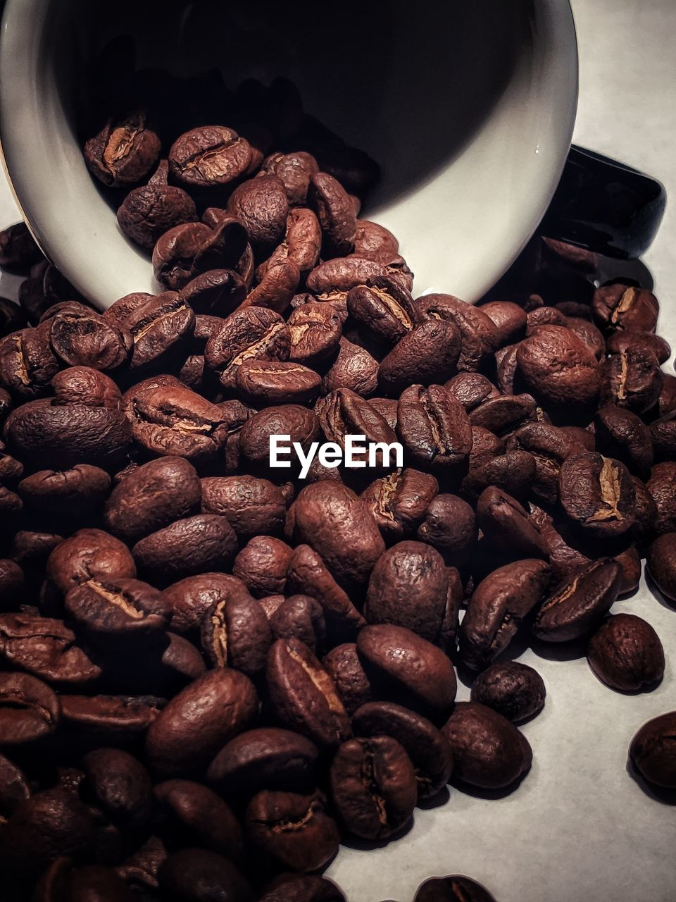 food and drink, roasted coffee bean, coffee - drink, coffee, food, brown, indoors, large group of objects, abundance, no people, freshness, coffee bean, roasted, caffeine, close-up, still life, refreshment, drink, high angle view, heap