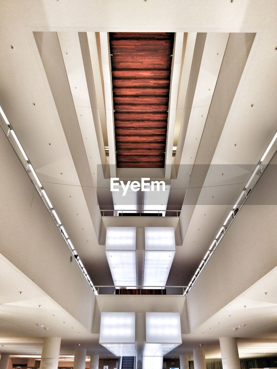 ceiling, indoors, architecture, illuminated, lighting equipment, no people, modern, low angle view, built structure, pattern, transportation, in a row, building, metal, empty, direction, white color, wall - building feature, light, window