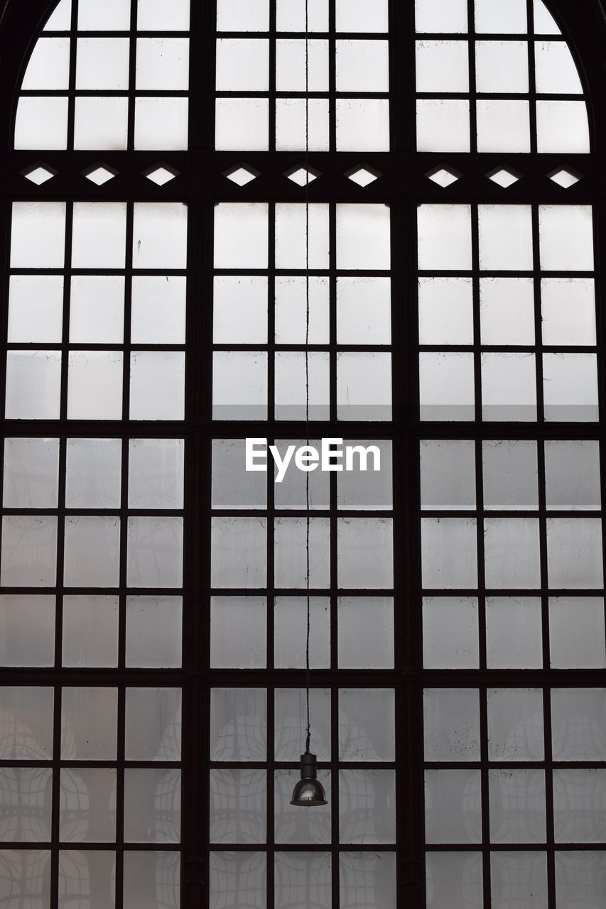 window, pattern, grid, architecture, indoors, full frame, metal, no people, building, built structure, grate, day, glass - material, low angle view, backgrounds, metal grate, security, prison, protection, ceiling