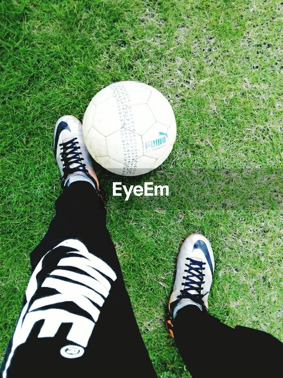 grass, shoe, one person, low section, human leg, human body part, personal perspective, real people, high angle view, human foot, standing, sport, canvas shoe, men, leisure activity, one man only, ball, soccer, green color, lifestyles, day, sock, outdoors, golf, only men, soccer shoe, close-up, people, adult, adults only