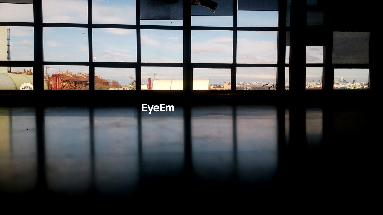 window, indoors, no people, architecture, reflection, built structure, day, sky, water, building exterior, close-up, nature, city