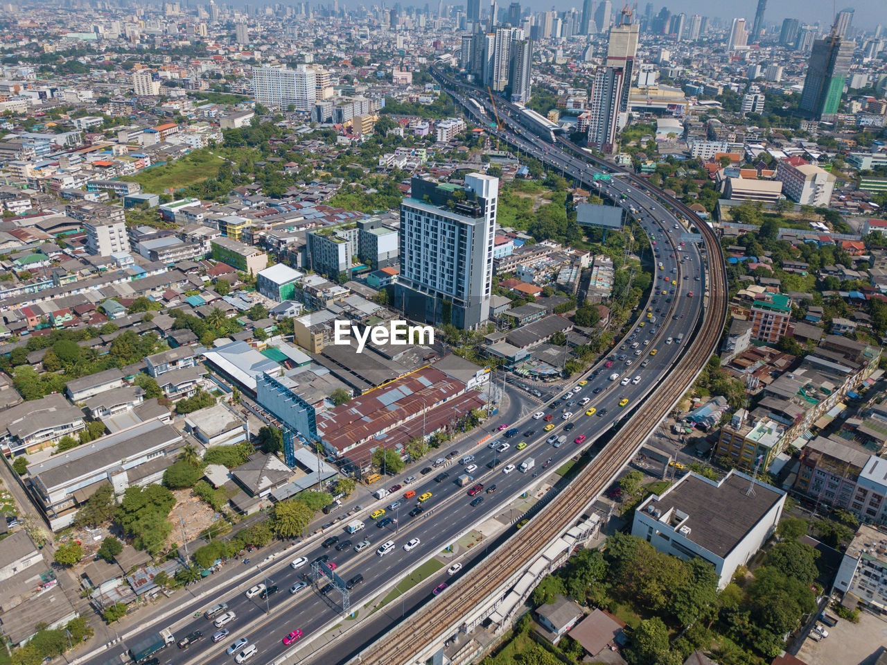 city, cityscape, high angle view, aerial view, architecture, skyscraper, transportation, modern, building exterior, downtown district, day, outdoors, urban skyline, no people, built structure, sky