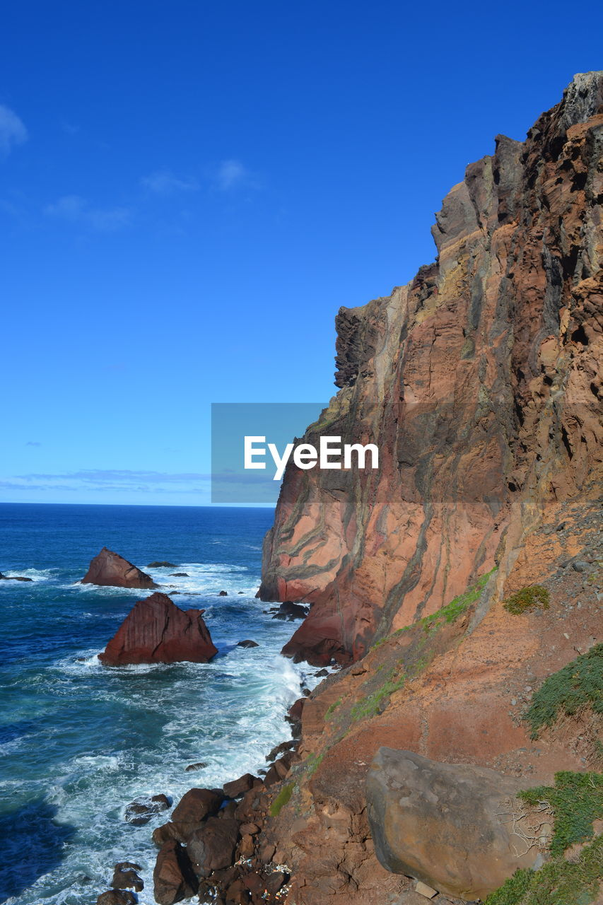 water, sky, sea, rock, beauty in nature, blue, scenics - nature, rock - object, solid, land, rock formation, nature, tranquil scene, no people, tranquility, day, beach, non-urban scene, cliff, outdoors, horizon over water