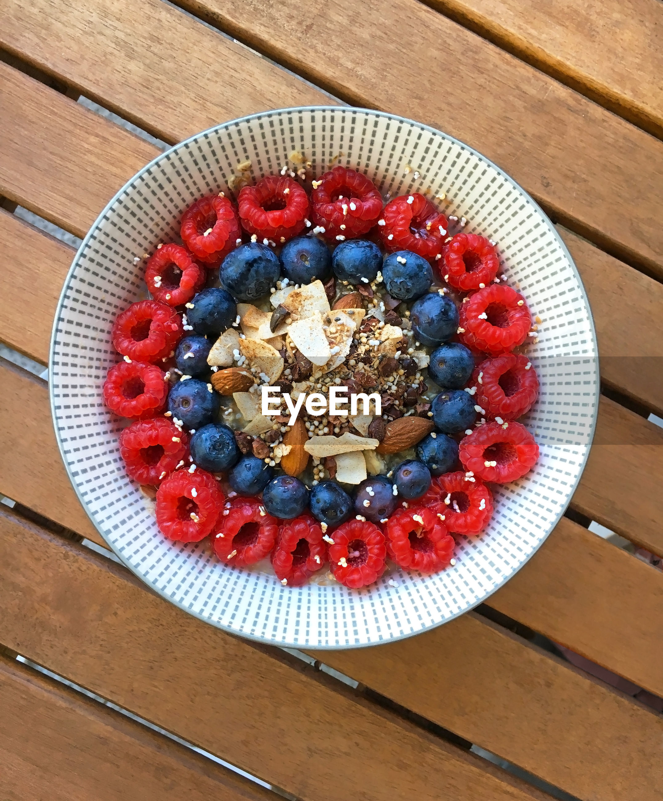 food, food and drink, berry fruit, fruit, blueberry, healthy eating, wellbeing, breakfast, wood - material, directly above, bowl, freshness, table, indoors, breakfast cereal, granola, meal, no people, raspberry, still life