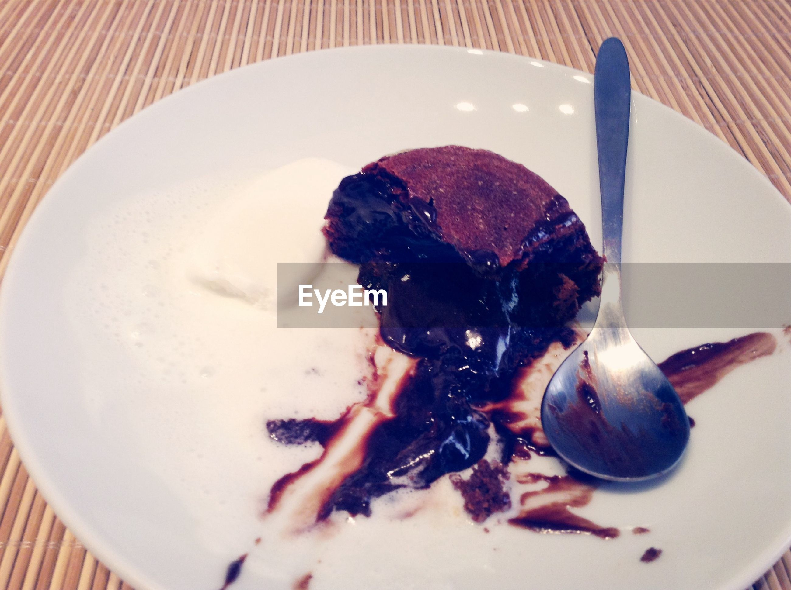 food and drink, food, indoors, sweet food, dessert, freshness, indulgence, plate, ready-to-eat, ice cream, high angle view, frozen food, one person, close-up, unhealthy eating, temptation, cake, spoon, chocolate, holding