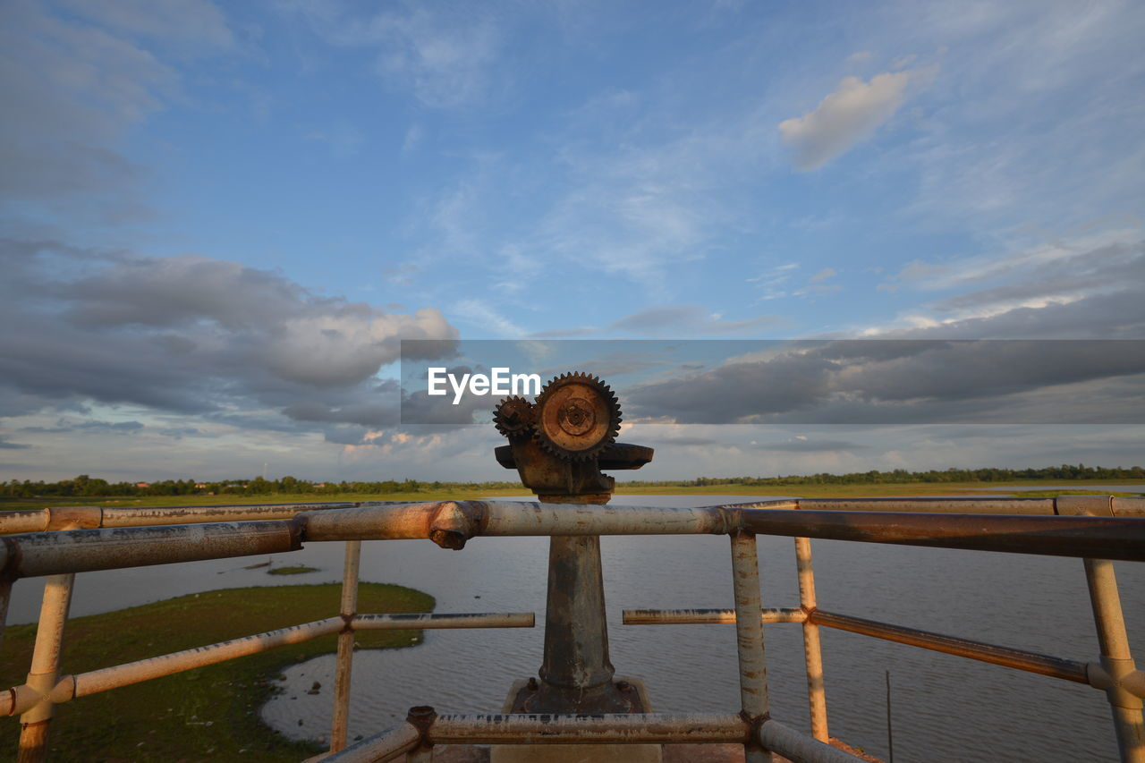 cloud - sky, water, sky, nature, railing, no people, beauty in nature, lake, day, wood - material, tranquility, scenics - nature, tranquil scene, outdoors, pier, non-urban scene, metal, idyllic