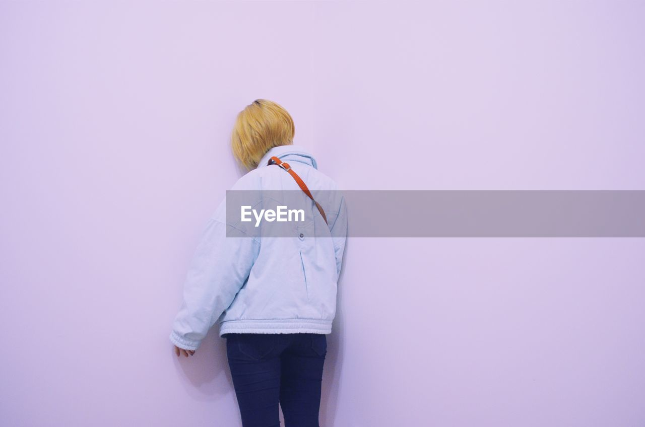 Woman Standing Against The Wall