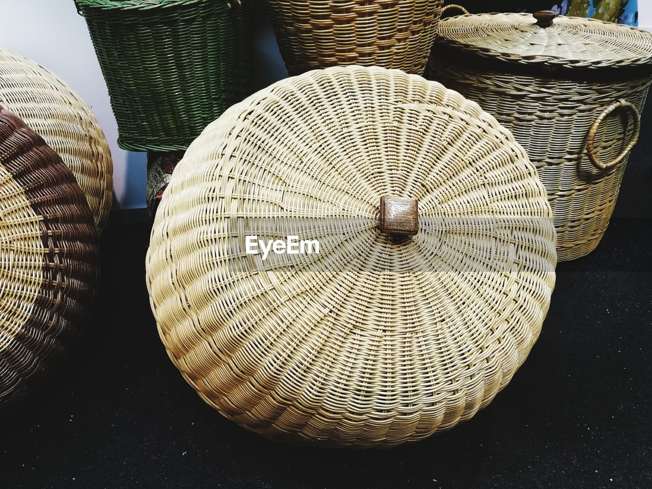 basket, wicker, no people, pattern, close-up, art and craft, still life, container, hat, indoors, choice, craft, table, for sale, market, variation, group of objects, large group of objects, high angle view