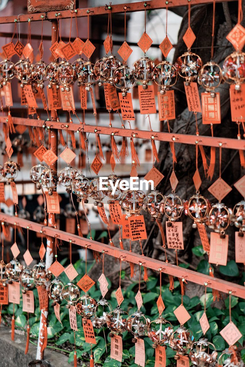 large group of objects, no people, abundance, for sale, arrangement, choice, day, hanging, in a row, retail, variation, script, communication, non-western script, price tag, text, focus on foreground, architecture, outdoors, nature, retail display