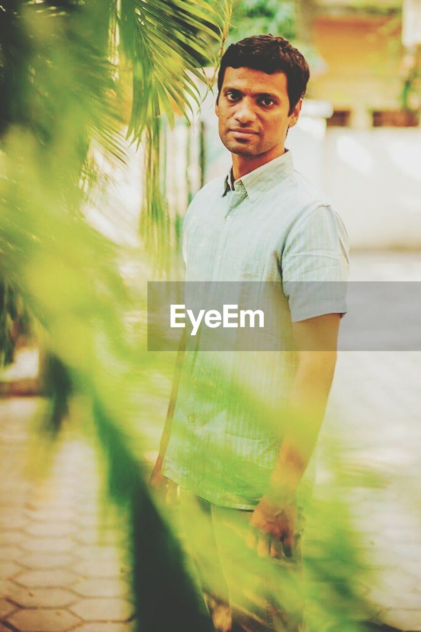 real people, one person, looking at camera, young adult, front view, portrait, standing, young men, casual clothing, day, outdoors, lifestyles, nature, adults only, adult, people