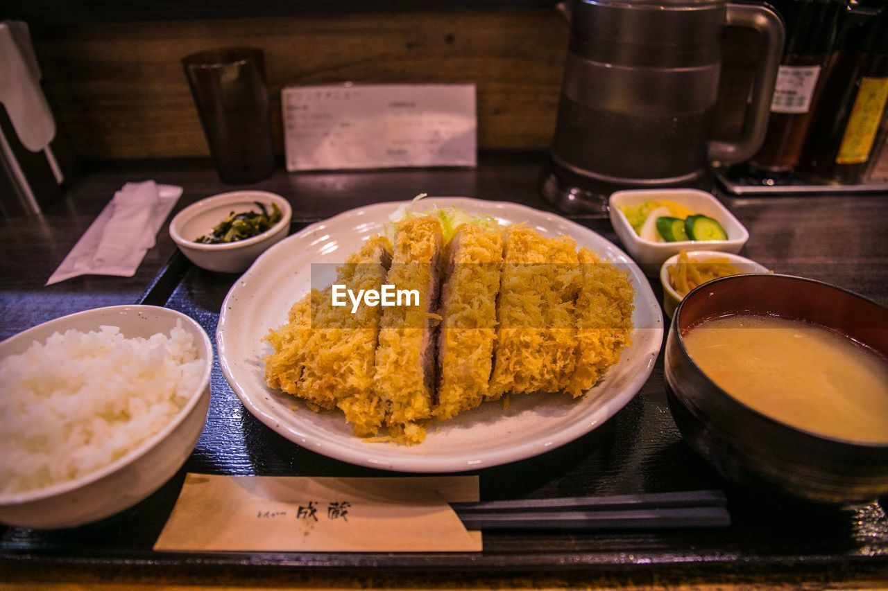food and drink, food, freshness, table, bowl, indoors, ready-to-eat, healthy eating, asian food, still life, plate, no people, wellbeing, close-up, kitchen utensil, serving size, high angle view, meal, eating utensil, tray, indian food, japanese food