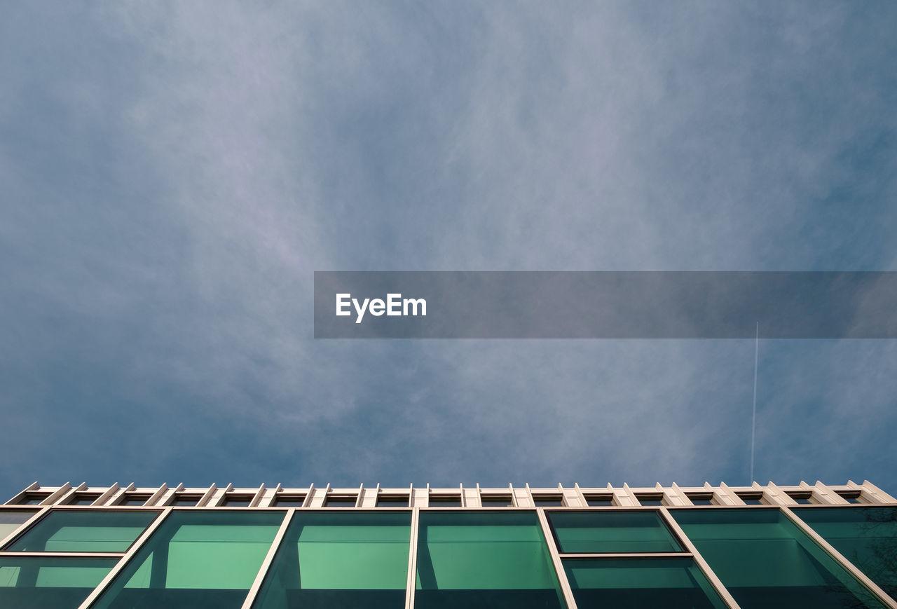 Directly Below Shot Of Modern Building Against Sky