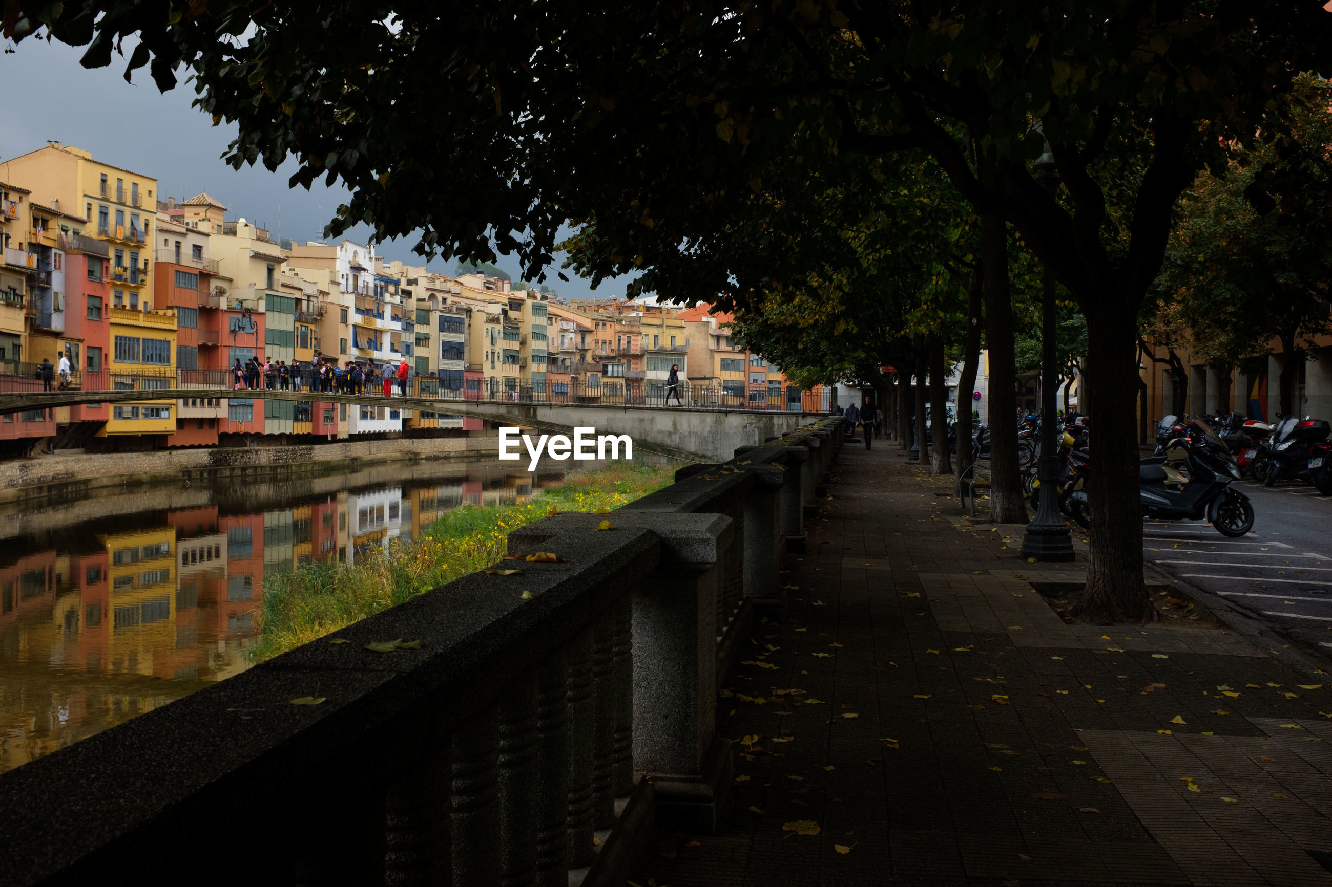 View of footpath by canal in city