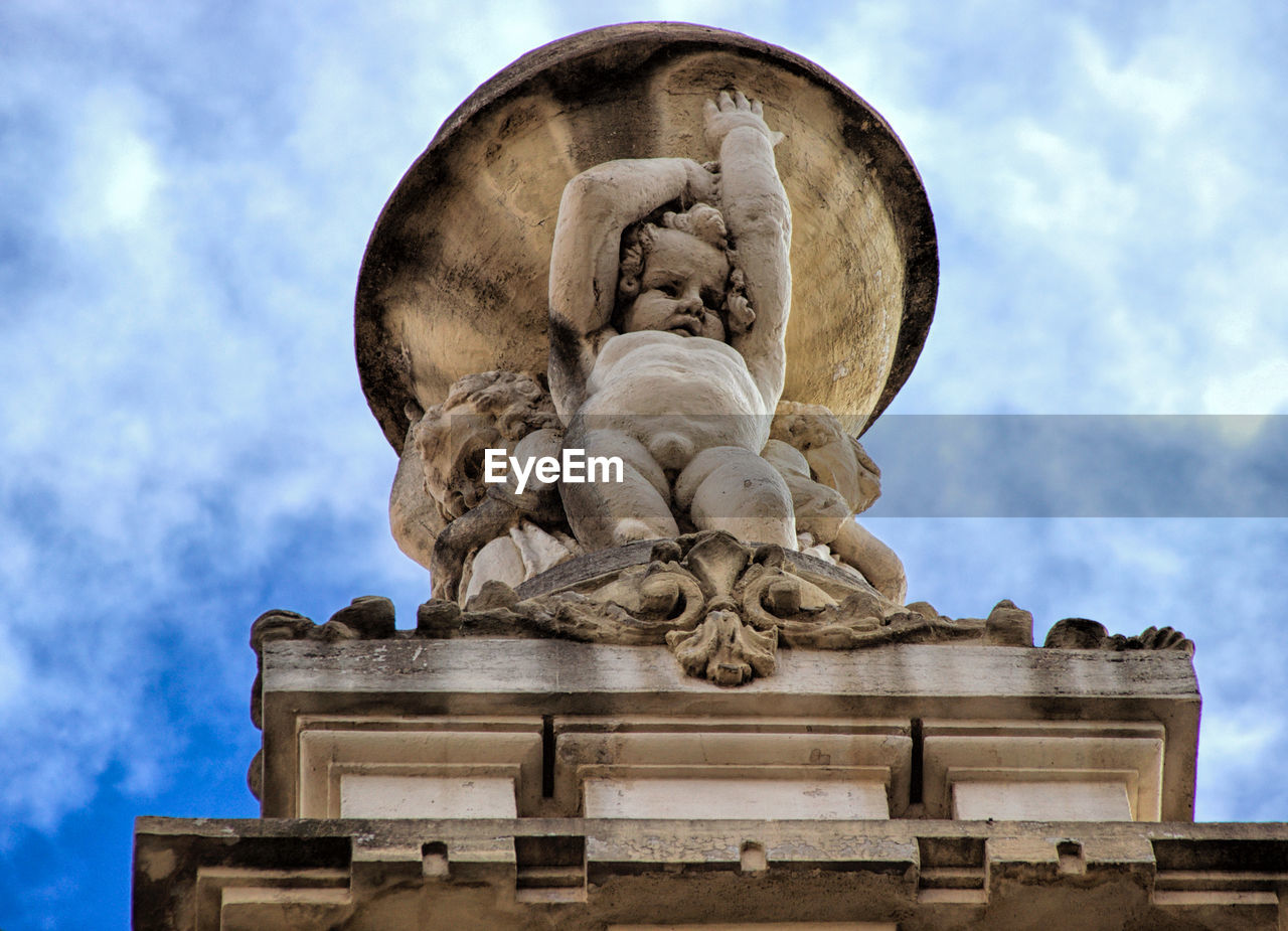 art and craft, sculpture, sky, representation, human representation, statue, cloud - sky, architecture, low angle view, creativity, craft, male likeness, no people, nature, day, female likeness, built structure, history, the past, memorial, outdoors, angel