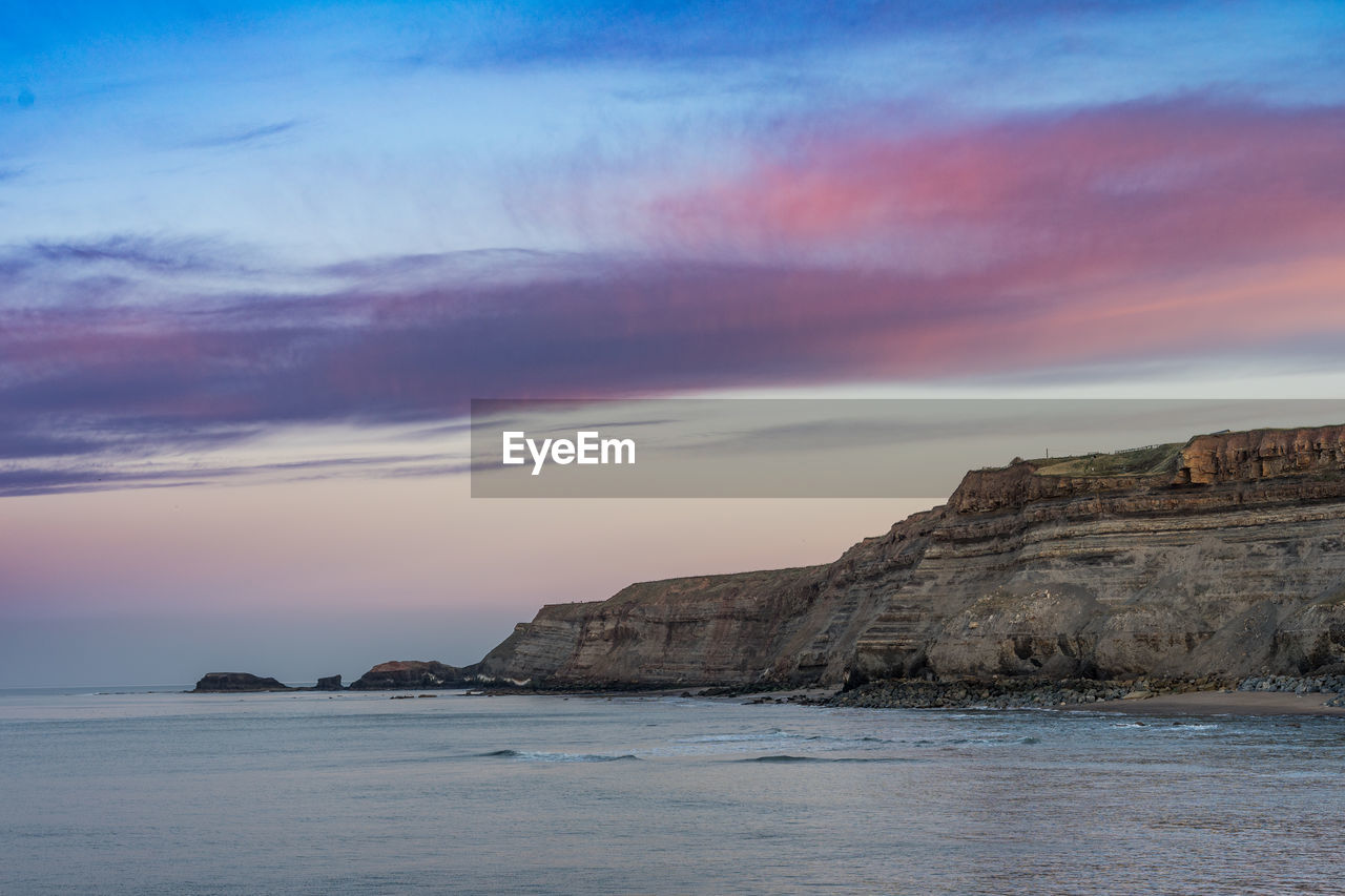 sky, sea, scenics - nature, beauty in nature, water, sunset, tranquility, tranquil scene, cloud - sky, no people, waterfront, rock, nature, land, beach, idyllic, non-urban scene, rock - object, horizon over water, outdoors