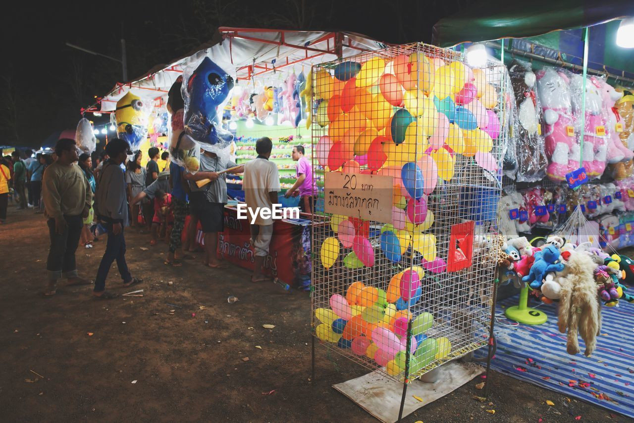 multi colored, retail, market, for sale, real people, market stall, people, choice, group of people, men, small business, creativity, variation, art and craft, hanging, street, women, large group of objects, day, sale, retail display