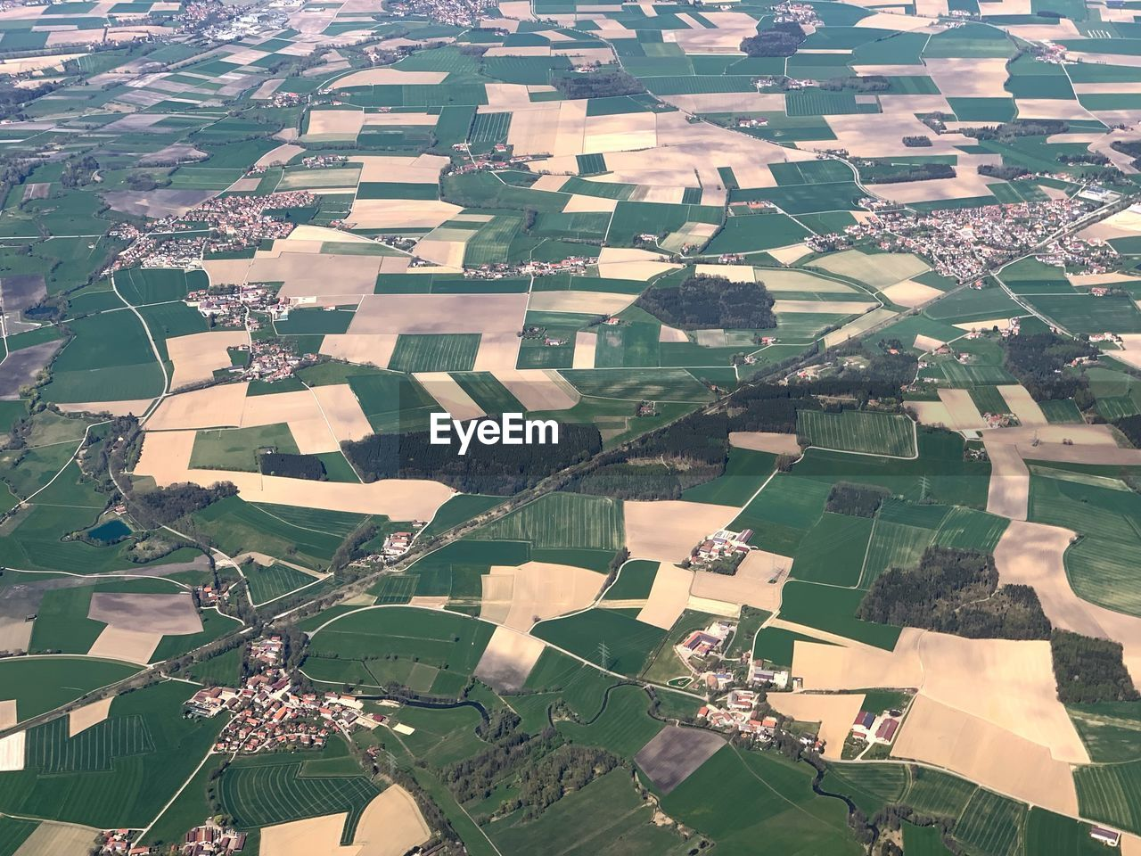 patchwork landscape, architecture, aerial view, nature, environment, day, no people, landscape, building exterior, agriculture, built structure, farm, building, high angle view, beauty in nature, field, full frame, rural scene, backgrounds, outdoors, cityscape