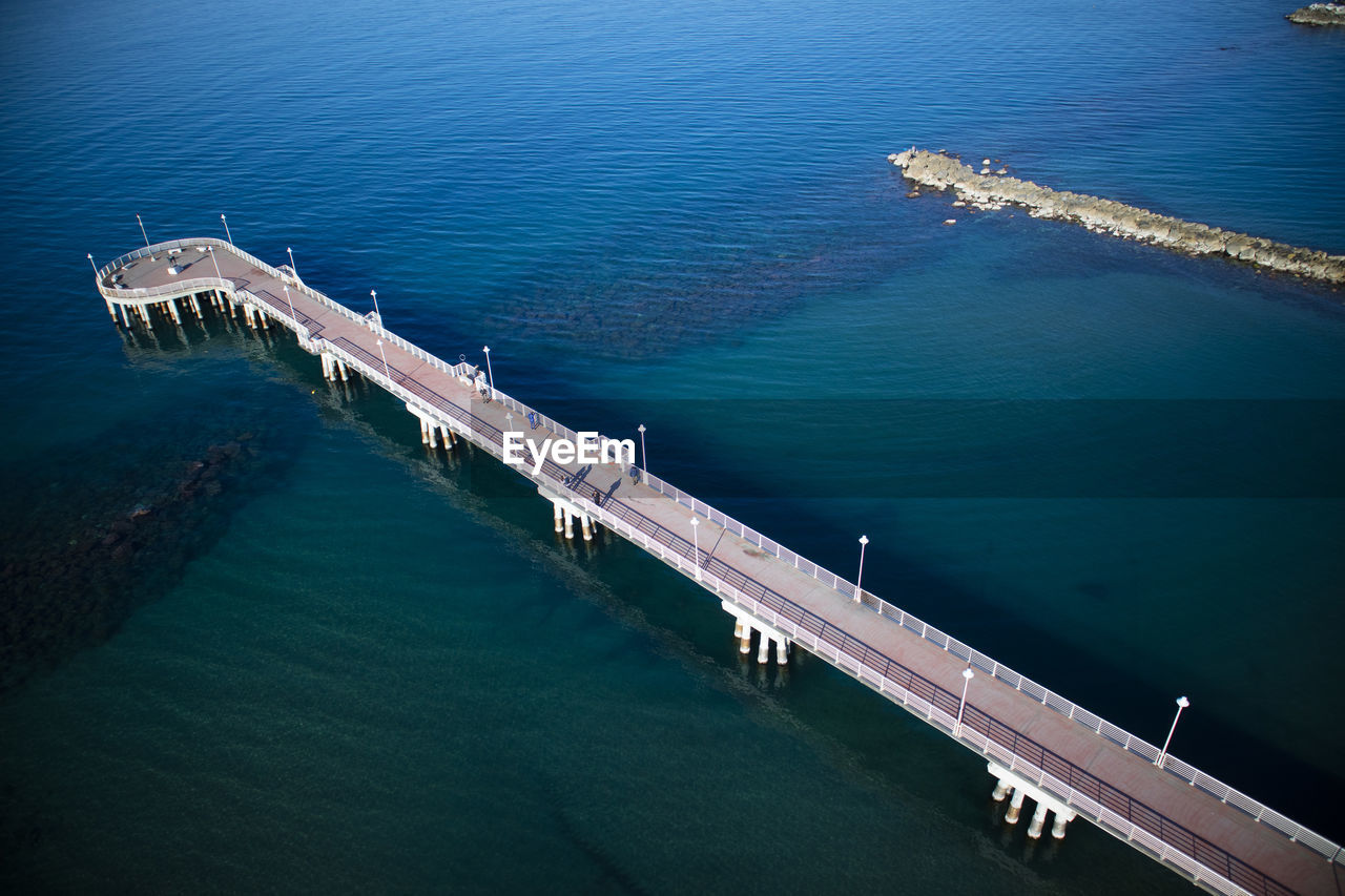water, high angle view, sea, architecture, built structure, transportation, nautical vessel, nature, no people, day, mode of transportation, connection, outdoors, bridge, waterfront, pier, bridge - man made structure, travel, freight transportation