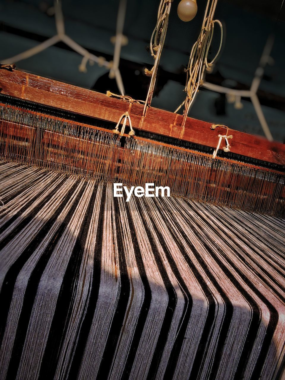 Close-up of handloom in factory