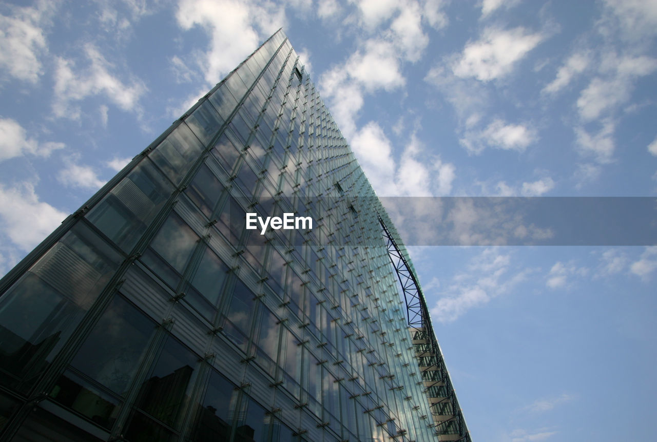 architecture, modern, low angle view, built structure, building exterior, reflection, sky, day, cloud - sky, no people, outdoors, skyscraper, city