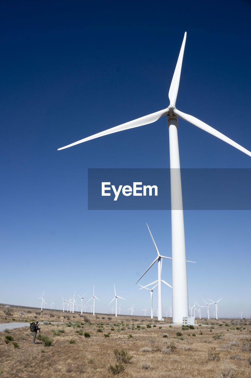 fuel and power generation, turbine, wind turbine, wind power, alternative energy, sky, renewable energy, environment, environmental conservation, nature, landscape, land, technology, clear sky, field, blue, day, beauty in nature, rural scene, sustainable resources, outdoors, no people