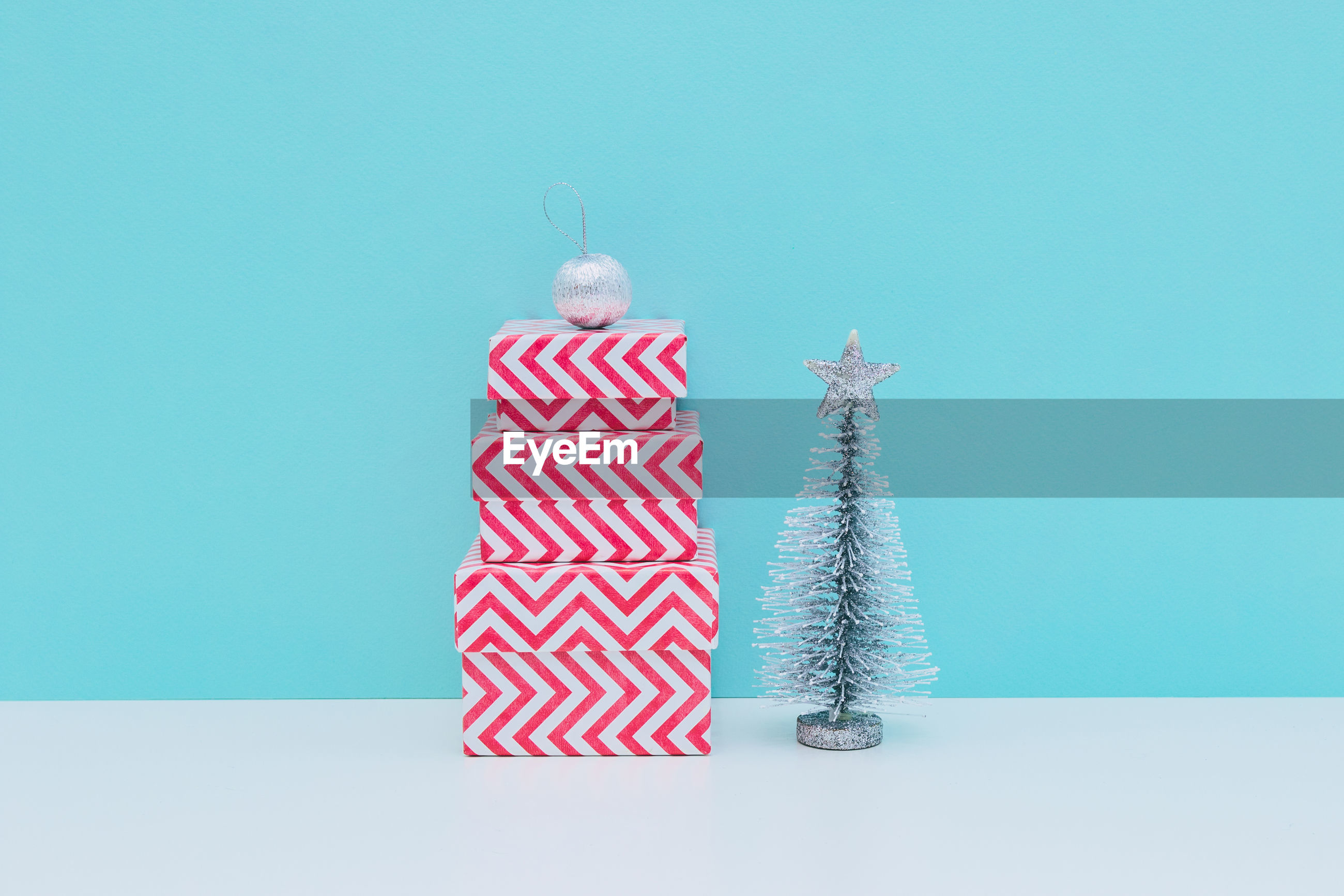 Christmas decoration on table against blue background
