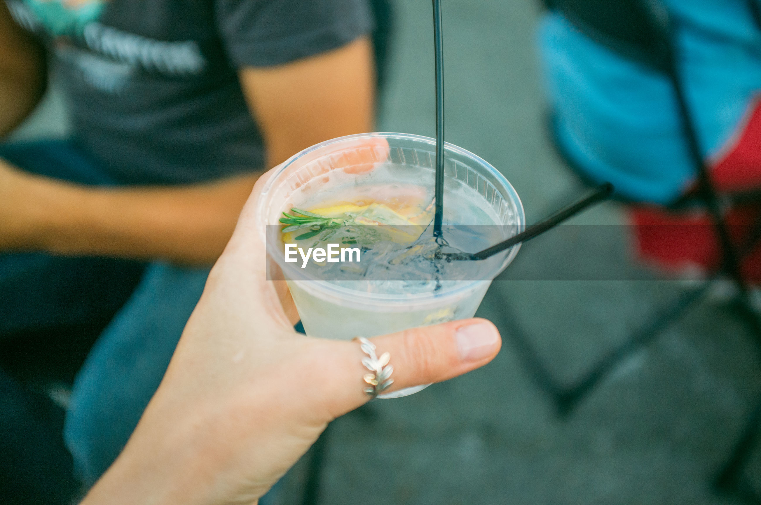 Cropped image of woman holding gin tonic cocktail