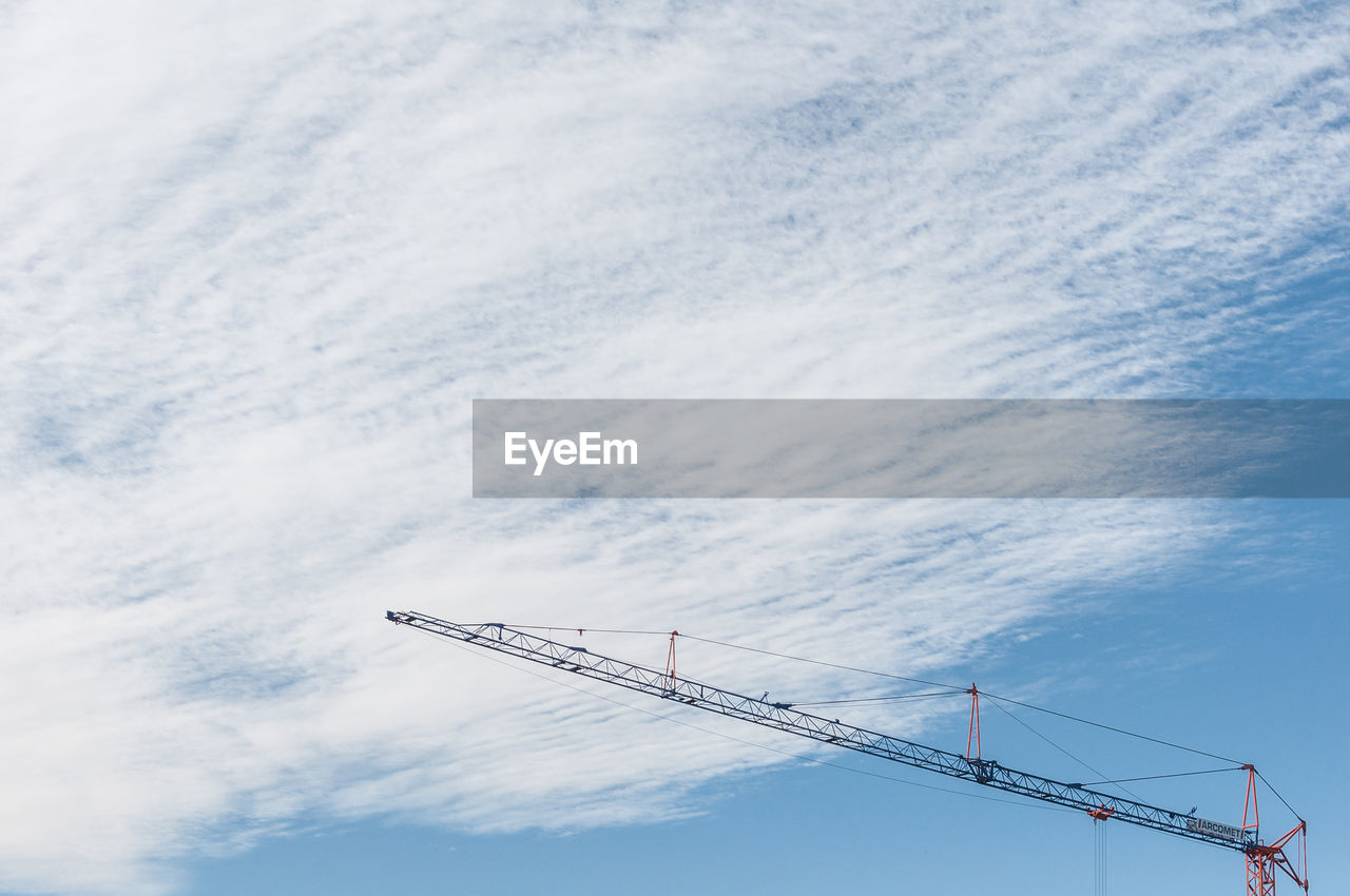 cloud - sky, crane - construction machinery, sky, machinery, low angle view, construction industry, industry, nature, day, no people, construction site, development, outdoors, construction machinery, beauty in nature, white color, construction equipment, crane, transportation, tall - high