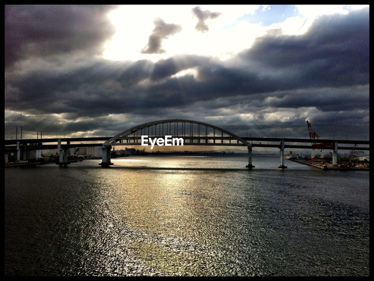 bridge - man made structure, connection, built structure, sky, architecture, cloud - sky, travel destinations, water, river, transportation, travel, no people, waterfront, outdoors, storm cloud, day, bridge, suspension bridge, nature, city